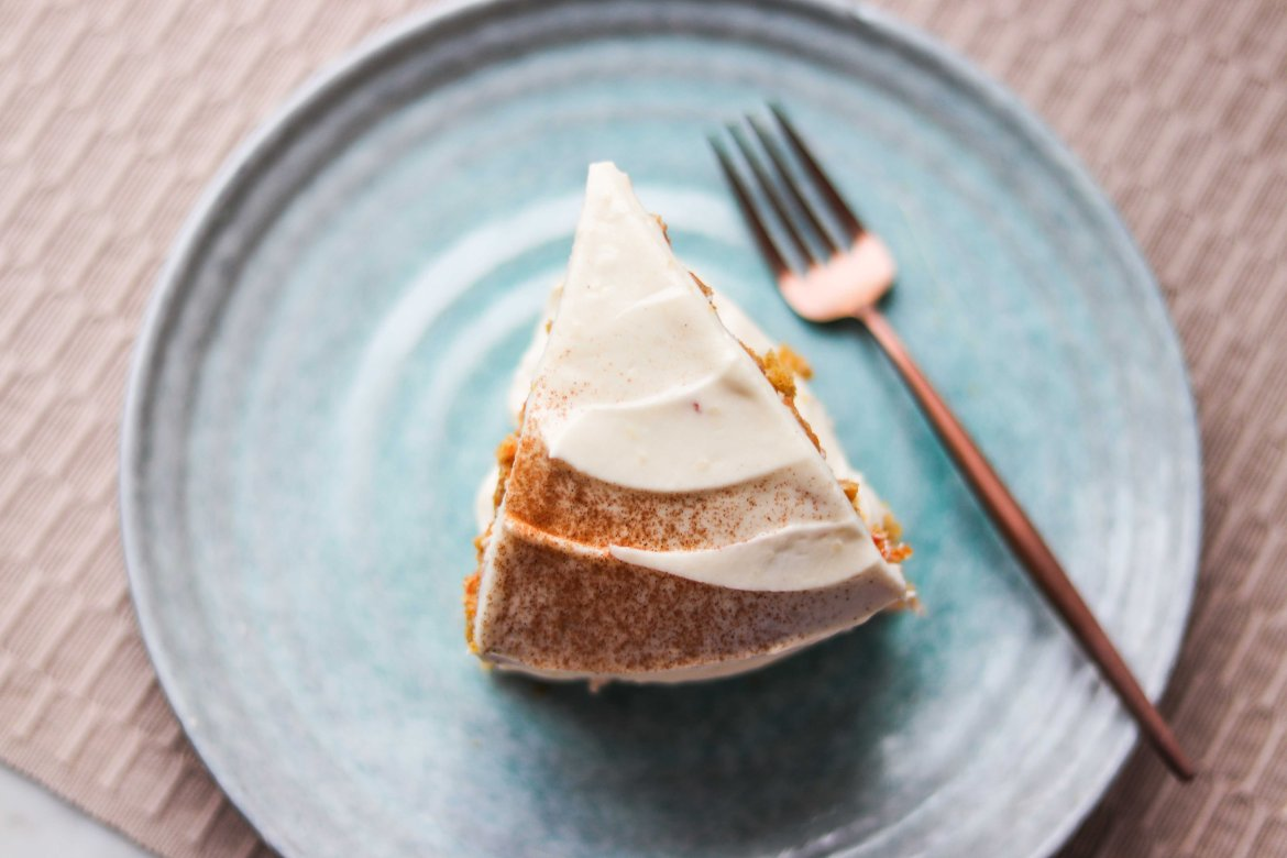 Slice of Almond Butter Carrot Cake with Cream Cheese Frosting